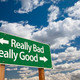 Really Bad, Really Good Green Road Sign with Dramatic Clouds and Sky. - PhotoDune Item for Sale