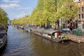 Houseboats on a Canal in Amsterdam - PhotoDune Item for Sale