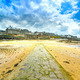 Saint Malo beach and stone pathway, low tide. Brittany, France. - PhotoDune Item for Sale