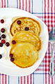 Flapjacks with cranberry in a plate on a napkin - PhotoDune Item for Sale