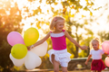 Two little girls with balloons - PhotoDune Item for Sale