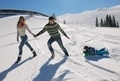 family having fun on fresh snow at winter vacation - PhotoDune Item for Sale