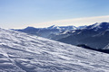 Ski slope with trace of ski, snowboards and mountains in haze - PhotoDune Item for Sale