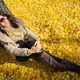 woman sit on ground be filled with leaves of ginkgo tree in fall at japan - PhotoDune Item for Sale