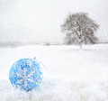 Blue Christmas ball with snowfield as background - PhotoDune Item for Sale