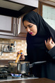 Arabian woman stirring food in the casserole   - PhotoDune Item for Sale