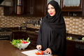Arabian woman preparing salad in the kitchen   - PhotoDune Item for Sale
