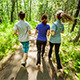 Young People Jogging in Wood - VideoHive Item for Sale