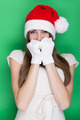 Cute bashful teenage girl with Santa hat - PhotoDune Item for Sale