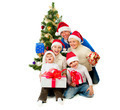 Christmas Family With Gifts near a Christmas Tree - PhotoDune Item for Sale