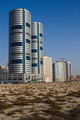 Sandy Desert and modern city in Sharjah UAE - PhotoDune Item for Sale