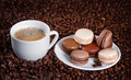 French macarons n the background of coffee beans - PhotoDune Item for Sale