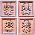 A set of four faces expressing different emotions over wood - PhotoDune Item for Sale