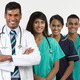 Indian medical team standing on white background - PhotoDune Item for Sale