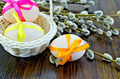 Easter eggs with colored ribbons on a blackboard - PhotoDune Item for Sale
