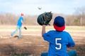 Two boys playing baseball at the park - PhotoDune Item for Sale