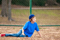 Cute boy sitting on grass - PhotoDune Item for Sale