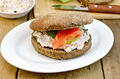 Sandwich with cream and salmon on a board with a knife - PhotoDune Item for Sale