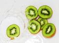 kiwi fruit in water on a white background - PhotoDune Item for Sale