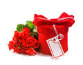 Red gift with a red bow and roses. Isolate on white background - PhotoDune Item for Sale