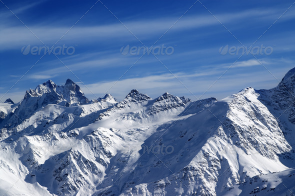 Snowy sunlight mountains, view from ski slope - Stock Photo - Images