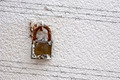 Shadow of barbed wire on wall with padlock - PhotoDune Item for Sale