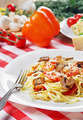 Pasta with shrimps and mashrooms on the wooden table - PhotoDune Item for Sale