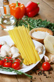 Pasta ingredients on the wooden table - PhotoDune Item for Sale
