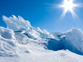Glacier ice chunks with snow and sunny blue sky - PhotoDune Item for Sale