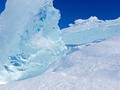 Clear glacier ice chunks with snow and blue sky - PhotoDune Item for Sale