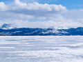 Frozen Lake Laberge winter landscape Yukon Canada - PhotoDune Item for Sale