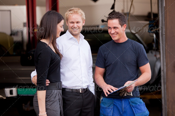 Mechanic with satisfied Customer - Stock Photo - Images