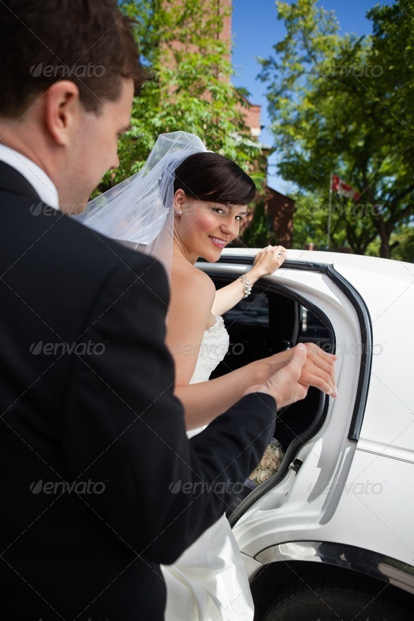 Bride and Groom with Limo - Stock Photo - Images