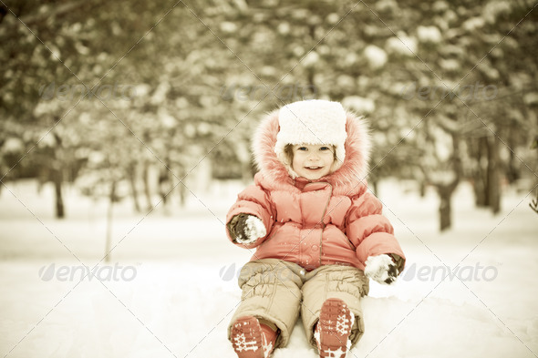 Stock Photo - PhotoDune Child playing at snowballs 681315