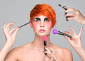 a young red-haired girl putting on makeup - PhotoDune Item for Sale