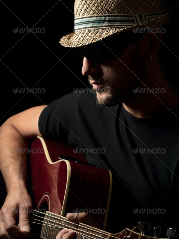 Guitarist playing solo on the acoustic guitar - Stock Photo - Images