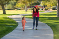 Beautiful mother and daughter running in the neighborhood - PhotoDune Item for Sale