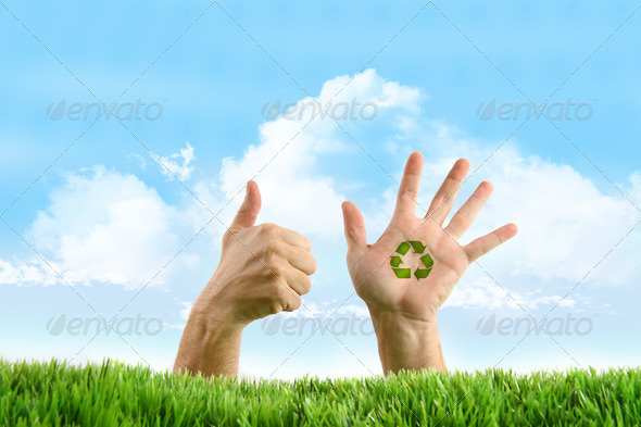 Hands with recycle sign in the grass - Stock Photo - Images