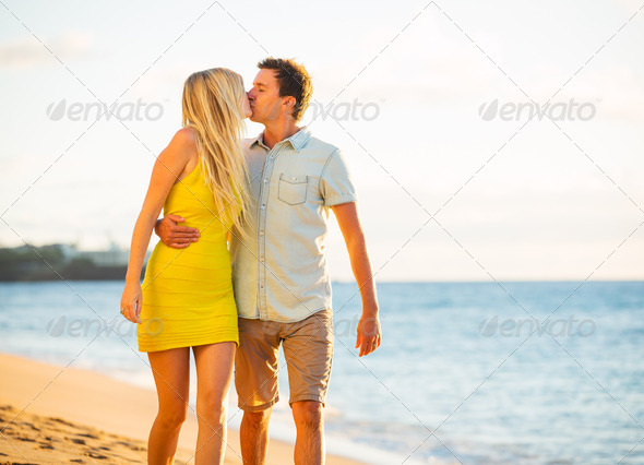 Couple Walking on the beach at Sunset, Romantic Vacation - Stock Photo - Images