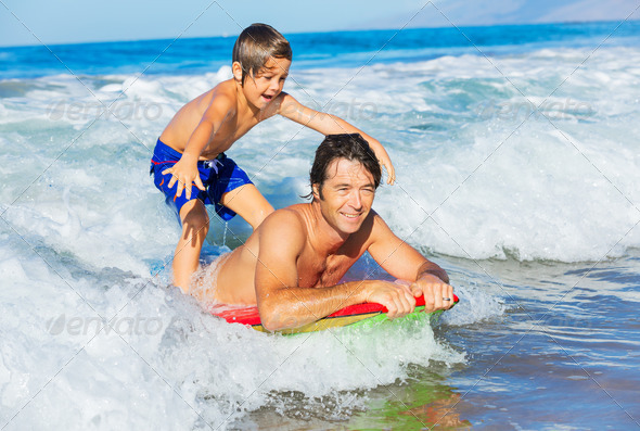 Father and Son Surfing Tandem Togehter Catching Ocean Wave, Care - Stock Photo - Images
