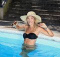 portrait the smart blonde in a hat in swimming pool an sunglasses - PhotoDune Item for Sale