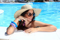 portrait the cute brunette in swimming pool with straw hat sunglasses - PhotoDune Item for Sale