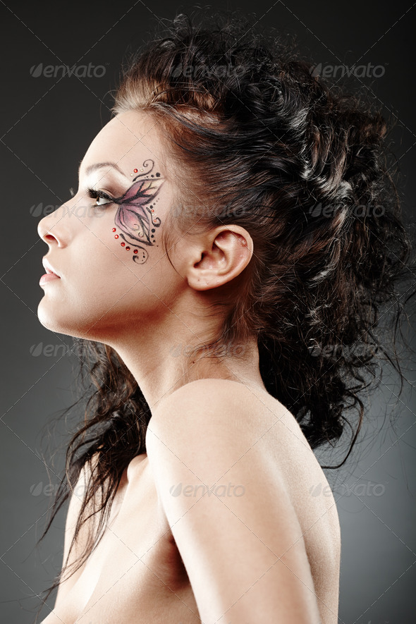 Beautiful woman with fantasy makeup - Stock Photo - Images