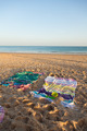Towels on the beach with sand toys - PhotoDune Item for Sale