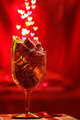 Festive background with glass, present boxes and hearts bokeh - PhotoDune Item for Sale