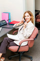 Businesswoman on telephone at office desk - PhotoDune Item for Sale