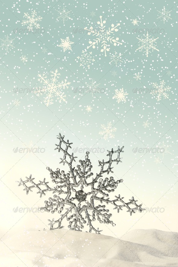 Sparkling snowflake in the snow - Stock Photo - Images