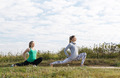 Two young girls exercising outdoors - PhotoDune Item for Sale