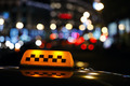 Illuminated taxi cab sign on a city street - PhotoDune Item for Sale