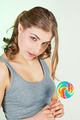 Teenager girl holding lollipop - PhotoDune Item for Sale